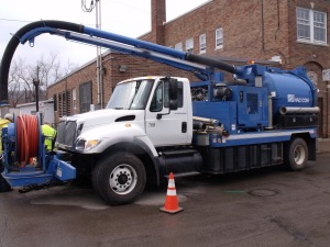 The Sewer Dept operates their Flusher Truck to keep storm drains clean.